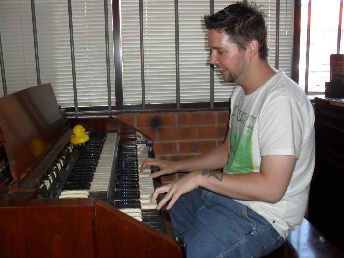 Main Street Studio's Adam Jordan. Producer Duck is observing Adam's organ playing skills. Photo by Mandy Craig.