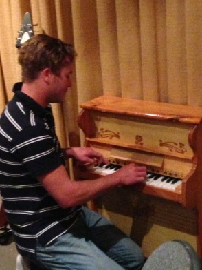 Clint Coker show us how its done playing the mini piano! Photo by Mandy Craig